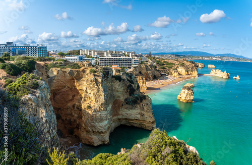 Wall mural Landscape with cliff, resort and Dona Ana beach at Algarve coast in Portugal