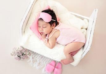 Charming newborn with pink sleep mask