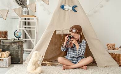 Pretty little girl playing in decorated room