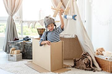 Little boy flying wooden plane