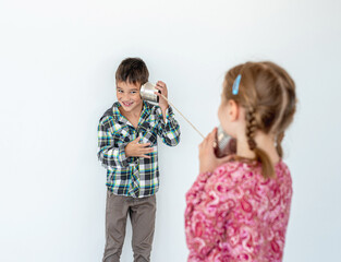 Children playing with self made telephone