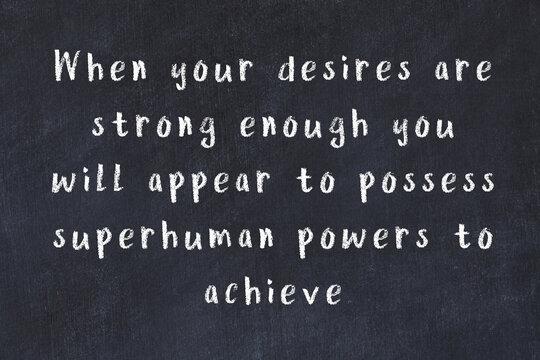 Chalk inscription of smart quote on black desk