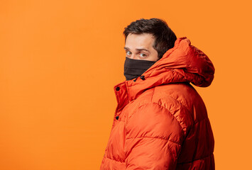 guy in face mask and down jacket