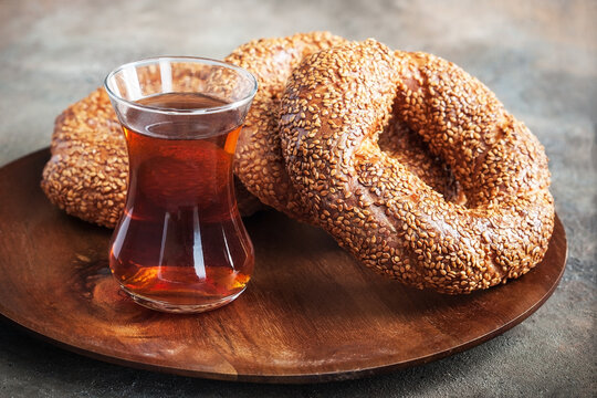 Turkish bagel simit and tea  in glass cup