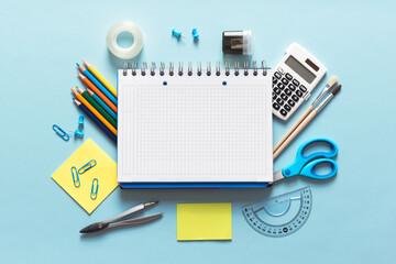 Back to school, stationery on blue background