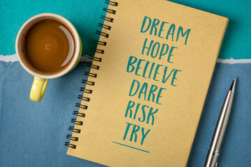 dream, hope, believe, dare, risk, try - creativity, inspirational and motivational concept, personal development,  handwriting in a spiral sketchbook with a cup of coffee