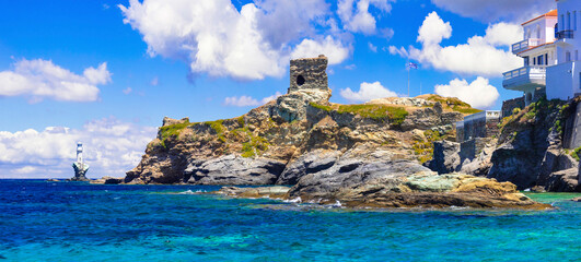 Andros island - panoramic view with ancient tower and light house. Greece, Cyclades