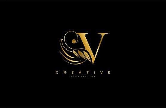 Initial V letter luxury beauty flourishes ornament golden monogram logo