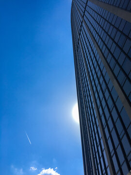 Very high Montparnasse tower in Paris under blue sky