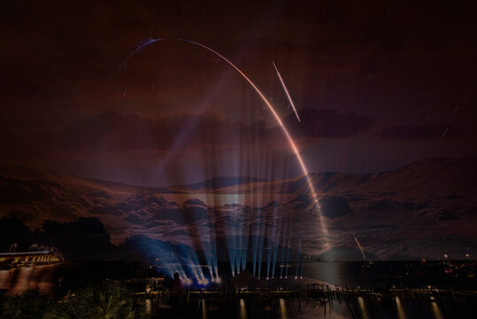 Missile launch, spotlight illumination. Elements of this image furnished by NASA.