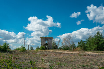 Ruins of concrete building at former military training area Jueterbog in late summer