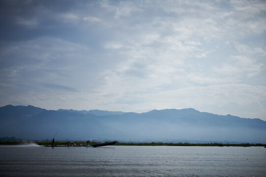 Inle Lake is in the Shan Hills of Myanmar. At its southwestern edge, Phaung Daw Oo Paya is a tiered pagoda with gilded Buddha statues. In the hills, near the market town of Indein, the stupas of Shwe