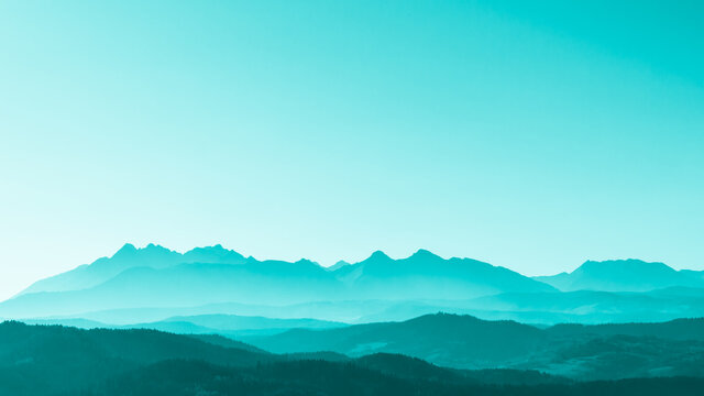 Green surreal mountains against the backdrop of a turquoise sky, fantastic fairytale mountain landscape