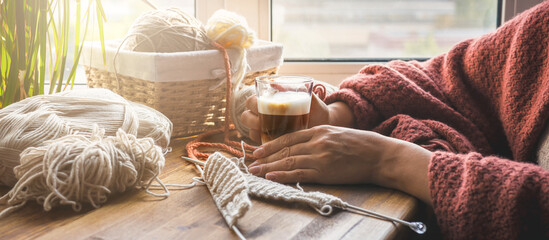 Knitting from threads at home. Hobby, relaxation, meditation, mental health during the quarantine period of the coronavirus lockdown. Stay at home, handmade, hobby, digital detox, zero waste,upcycling