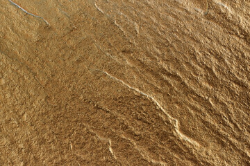 Golden stone texture as a background.