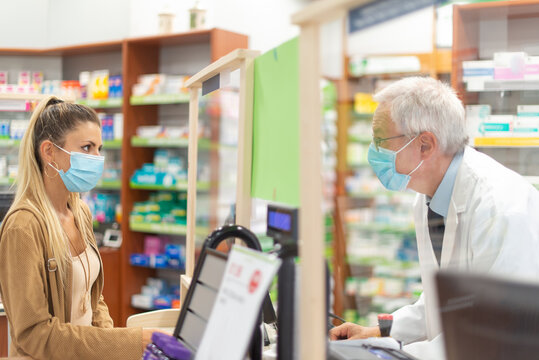 Woman checking out in a pharmacy, coronavirus concept