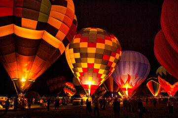 Night glow from hot air balloons; Albuquerque, New Mexico