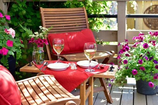 Outdoor al fresco patio table with beautiful place settings for relaxing dining on a warm summer evening
