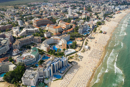 Suny Beach, Bulgaria - August 09, 2019: Aerial image a drone resort in Bulgaria on Black Sea coast. Many hotels and beaches with tourists, sunbeds and umbrellas. Sea travel destination. Travel