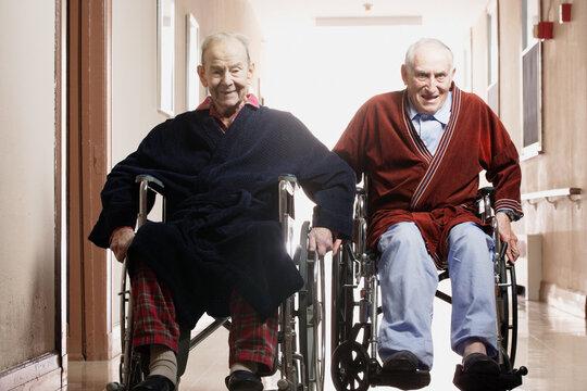 Elderly men racing in wheelchairs