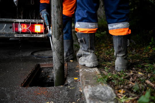 Cleaning storm drains from debris, clogged drainage systems are cleaned with a pump and water