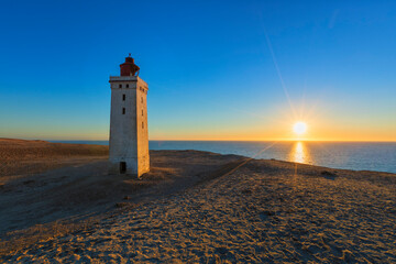 Denmark's most famous lighthouse Rubjerg Knude Fyr at sunset