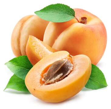Apricots with leaves and apricot slices isolated on a white background.