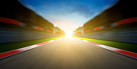 Motion blurred effect. International race track during sunset