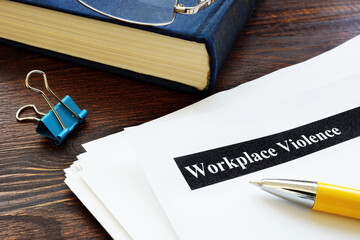 Fototapeta Workplace violence report papers and yellow pen. obraz