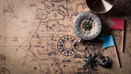 Happy Columbus Day  background concept with compass and retro treasure manuscript.  Flat lay, top view with copy space.