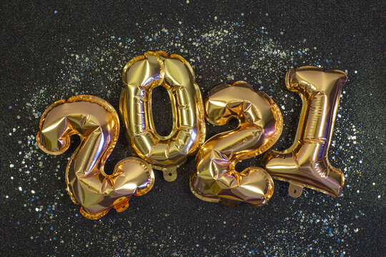 Gold Foil balloons in the form of numbers 2021.