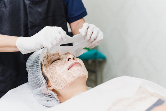 Beautiful woman in the spa salon, Treatment hyperpigmentation and melasma on face by serum mask.