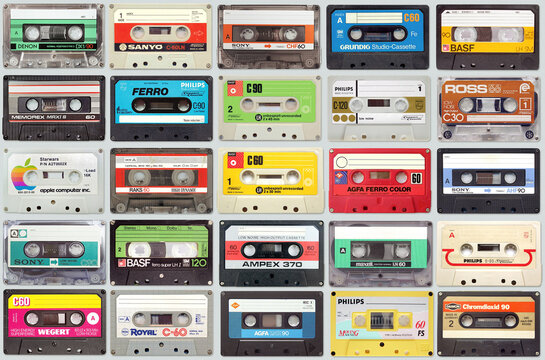 Large set of old vintage audio tape cassettes on gray background, colorful retro music background on September 19, 2020 in Vilnius, Lithuania