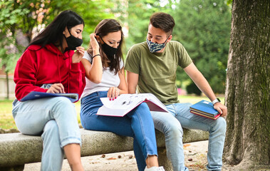Door stickers Wall Decor With Your Own Photos Three students studying together sitting on a bench outdoor and wearing masks during coronavirus times