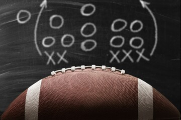 American leather football ball on background