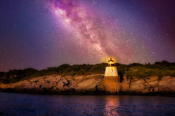 Beautiful stars of the Milky Way Galaxy over Castle Hill Lighthouse in Rhode Island
