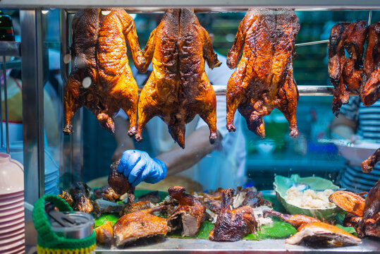 Hanging Roast Ducks on a Rack in the Restaurant,The duck Roasted for sale at Chinese market in Thailand.