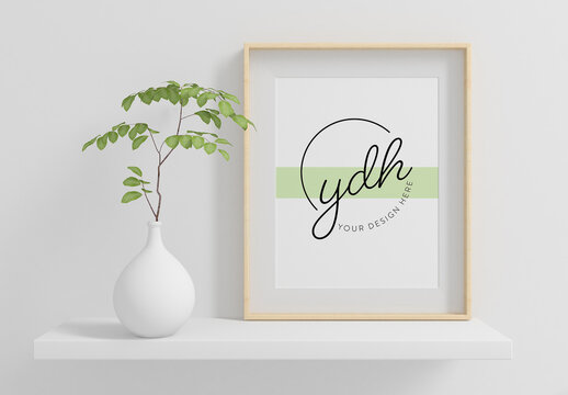 Vertical Frame on a Shelf with Plant Mockup