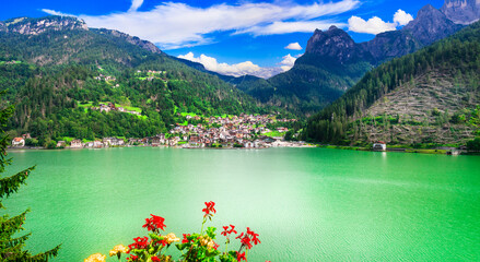 Amazing alpine scenery, Dolomites mountains. Beautiful lake lago di Alleghe, northern Italy (Belluno province)