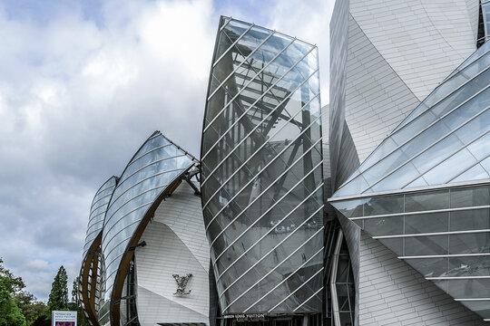 Modern architecture of Louis Vuitton Foundation (American architect Frank Gehry, 2014). Louis Vuitton Foundation is an art museum and cultural center. PARIS, FRANCE. APRIL 25, 2015.