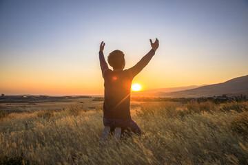 Aluminium Prints Landscapes man praying at the sunset