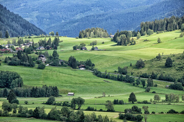 Green pastures in Austria with houses and cottages
