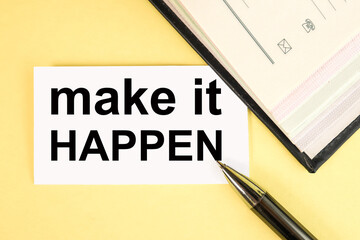 make it happen. text on white paper on yellow background