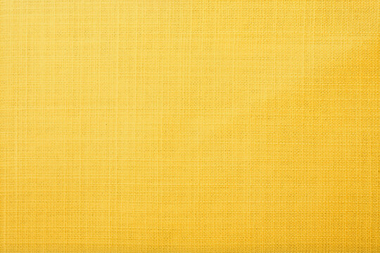 Golden yellow linen fabric of table cloth texture background