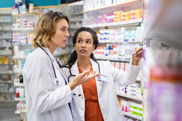 Doctor and pharmacist working at pharmacy