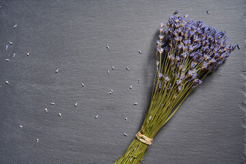 A bunch of lavender flowers on on stone surface