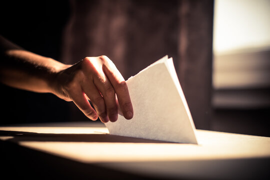 Conceptual image of a person voting during elections