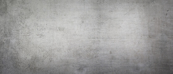 Texture of an old gray concrete wall as a background or wallpaper