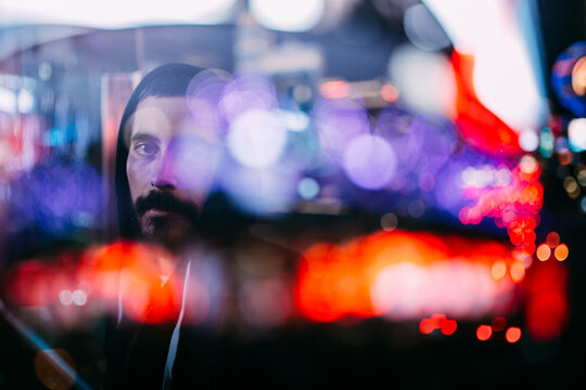portrait of a man through beautiful lights