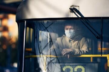 Man wearing face mask in public transportation